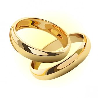 Anelli di oro di nozze isolati su bianco