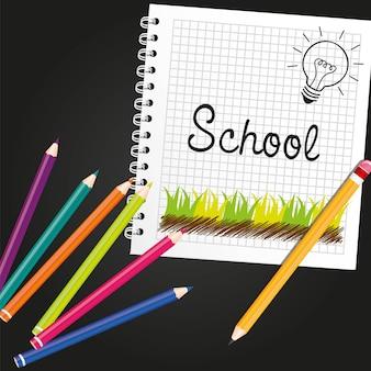 Anelli e matite del taccuino delle matite colorate isolati sul nero