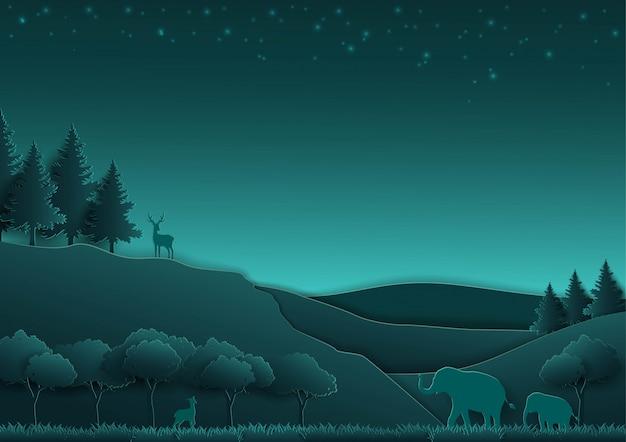 Animali e concetto della natura, arte di carta, foresta sul fondo di scena di notte