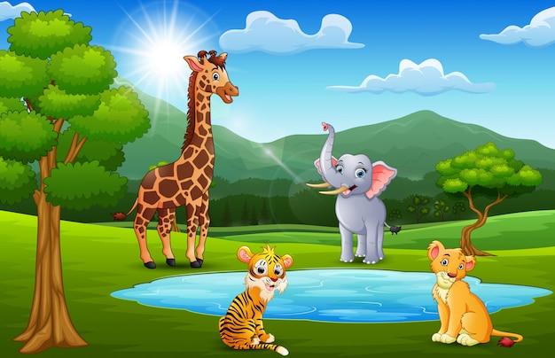 Animali felici che giocano accanto a piccoli stagni con paesaggi di montagna