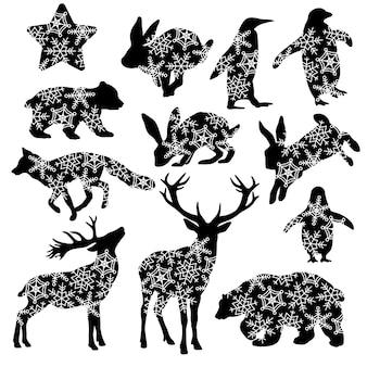 Animali invernali con fiocchi di neve