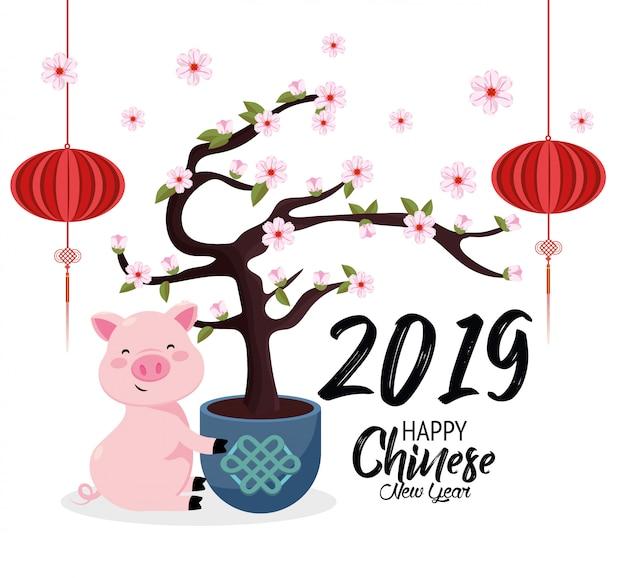 Anno cinese con fiori di ciliegio e maiale