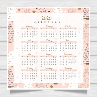 Anno nuovo calendario su sfondo di legno.