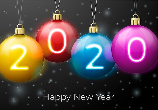 Anno nuovo con palline luminose e numeri 2020 su sfondo di notte invernale