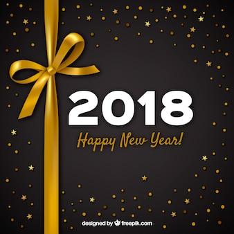 Anno nuovo sfondo 2018 con fiocco d'oro