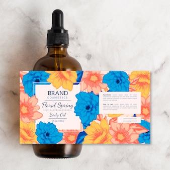 Annuncio cosmetico floreale con olio per il corpo primaverile