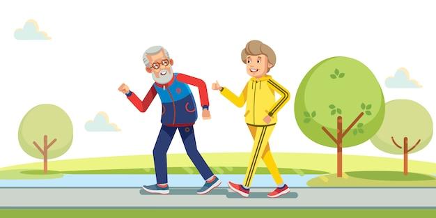 Anziani attivi felici che corrono fuori in natura verde.