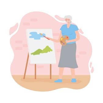 Anziani di attività, donna anziana che dipinge il paesaggio delle colline e del cielo su tela.