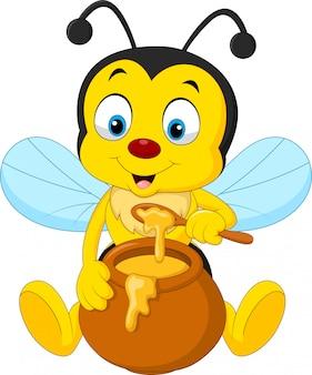 Ape di cartone animato con vaso di miele