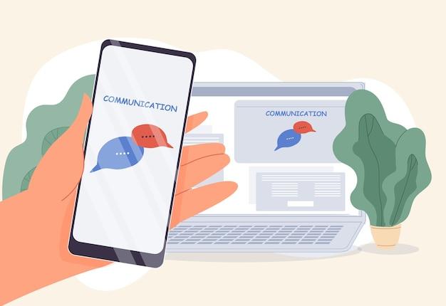 Applicazione internet per chat online per la moderna comunicazione wireless. computer sincronizzato con smartphone. mano umana che tiene il telefono cellulare. fumetto . scambio di dati, ricezione invia messaggio