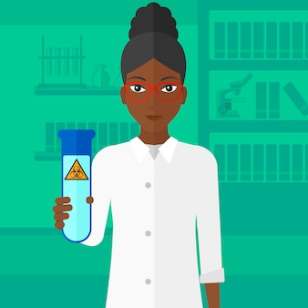 Assistente di laboratorio con provetta.