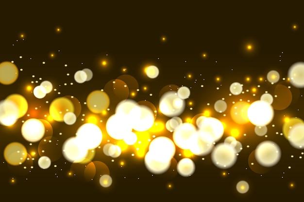 Astratto sfondo marrone con effetto luce dorata bokeh.