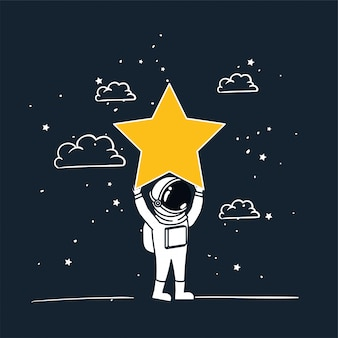 Astronauta disegna con stella gialla