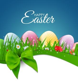 Auguri di buona pasqua con uova, erba, fiori