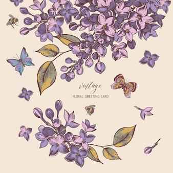 Auguri di primavera vintage con fiori che sbocciano di lillà