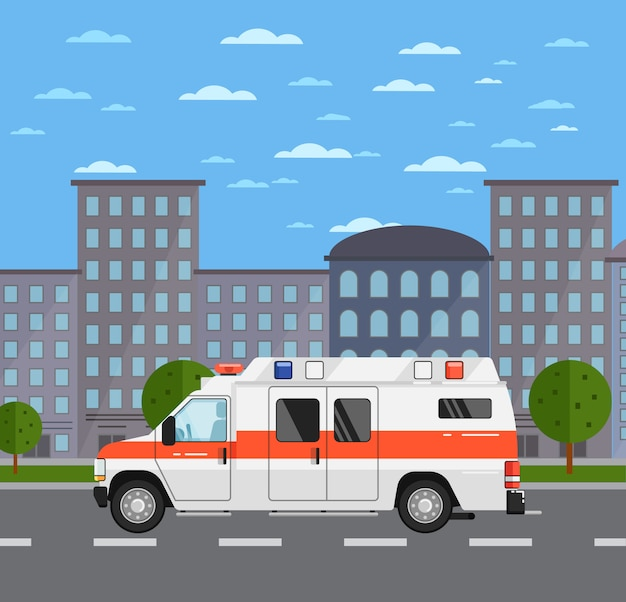 Automobile dell'ambulanza sulla strada nel paesaggio urbano