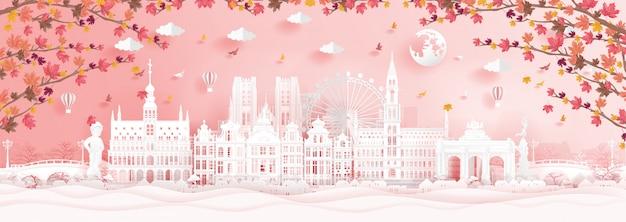 Autunno a bruxelles, in belgio con foglie d'acero che cadono e monumenti famosi del mondo