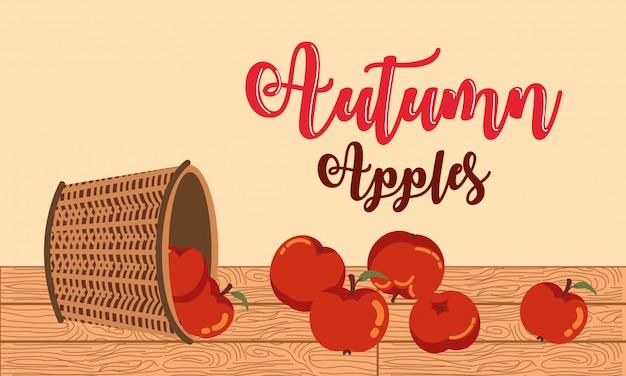 Autunno con l'illustrazione di vimini della merce nel carrello delle mele