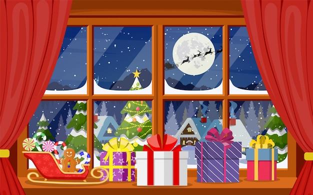 Babbo natale e le sue renne nella finestra.