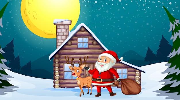 Babbo natale e renne davanti alla casa di legno