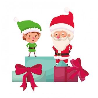 Babbo natale ed elfo con scatole regalo