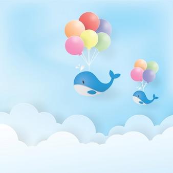 Balena blu volante con palloncini colorati, arte di carta, taglio di carta, vettore di artigianato, design