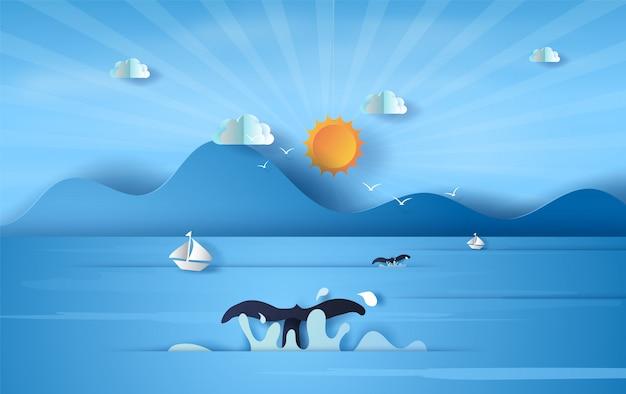 Balena di coda sul cielo blu di luce solare di vista del mare