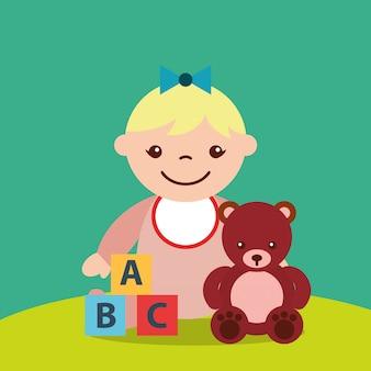 Bambina carina e orsacchiotto blocca giocattoli alfabeto