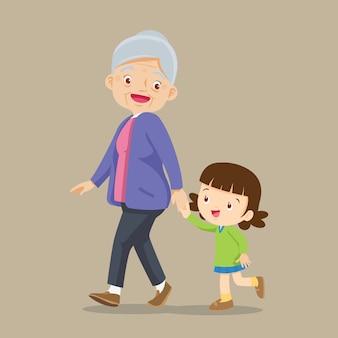 Bambina che cammina con sua nonna