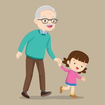 Bambina che cammina con suo nonno