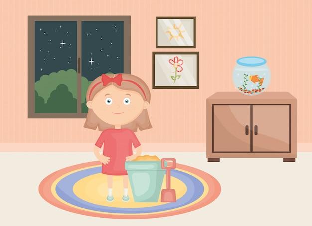 Bambina che gioca con i giocattoli nella stanza