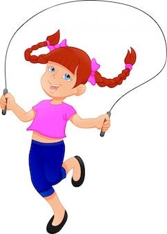 Bambina che gioca il salto della corda