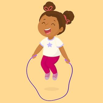 Bambina che gioca saltando la corda