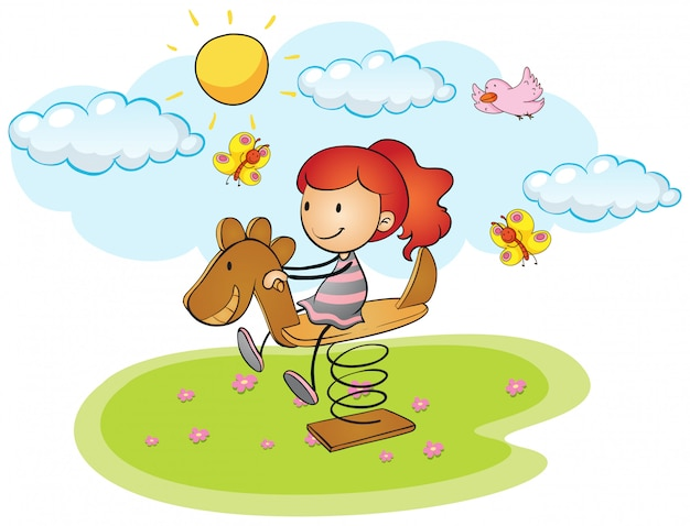 Bambina che gioca sul cavallo a dondolo