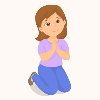 Bambina che prega in ginocchio