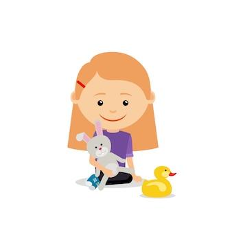 Bambina con coniglio giocattolo