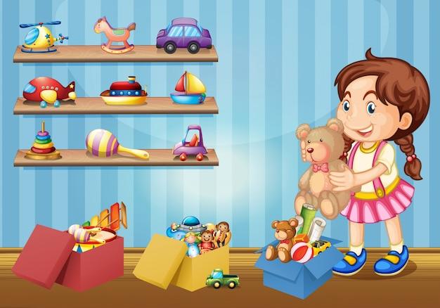 Bambina e tanti giocattoli