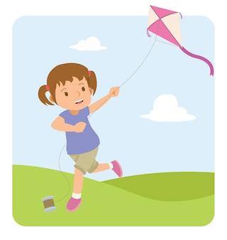 Bambina felice che gioca aquilone nel campo