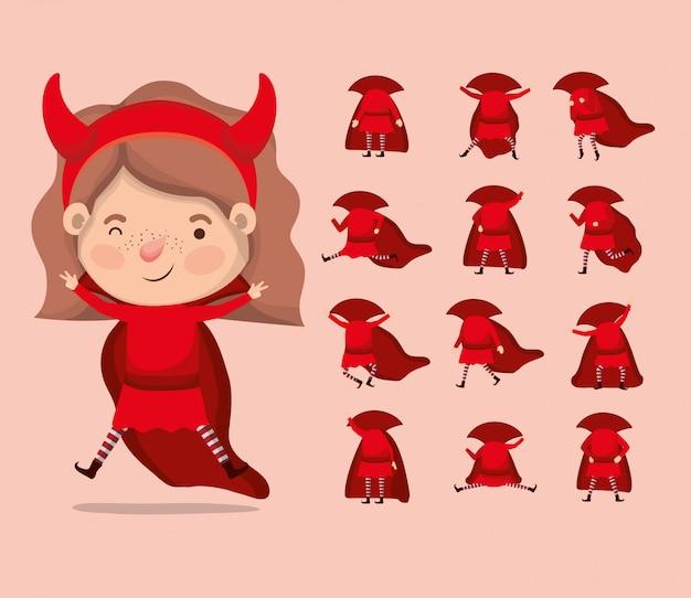 Bambina sveglia con il costume e gli accessori del diavolo