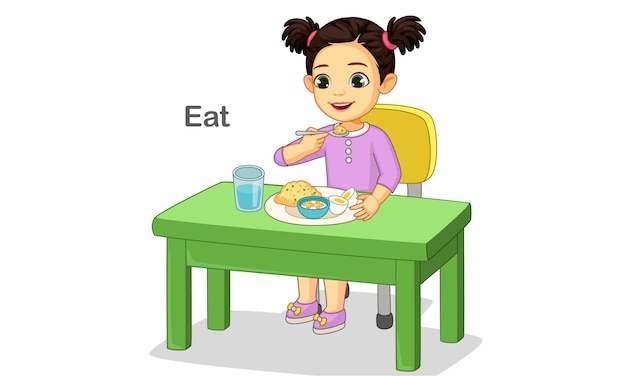 Bambina sveglia felicemente mangiando cibo
