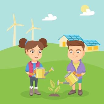 Bambini caucasici ecologici che innaffiano una pianta