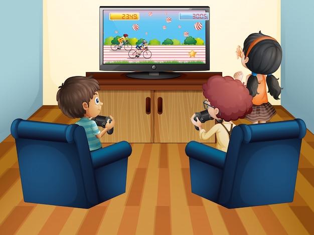 Bambini che giocano a computer game a casa