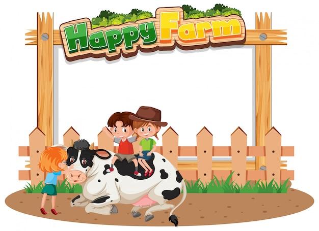 Bambini con una mucca in una fattoria