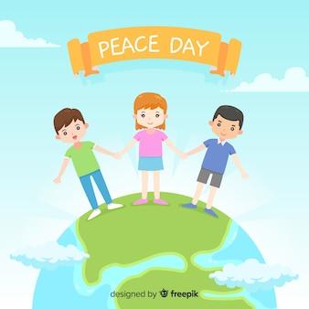 Bambini del fondo di giorno di pace che si tengono per mano intorno al mondo
