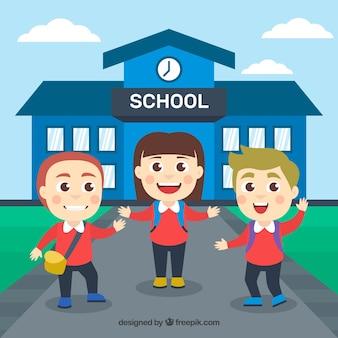 Bambini felici che arrivano a scuola