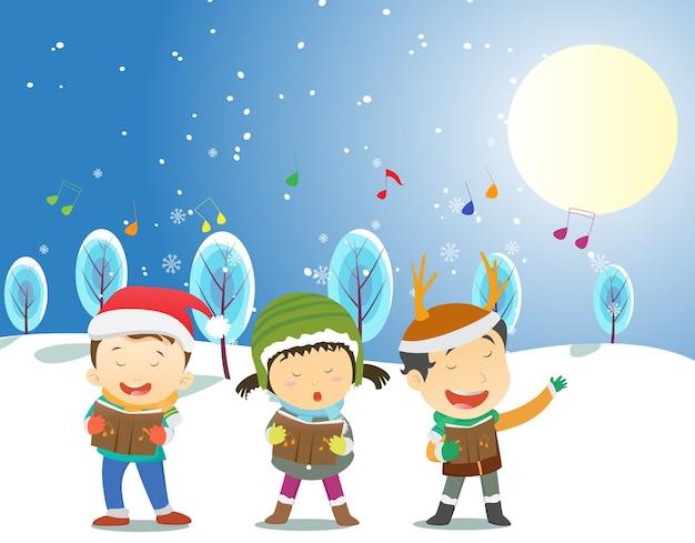 Bambini felici che cantano canti di natale