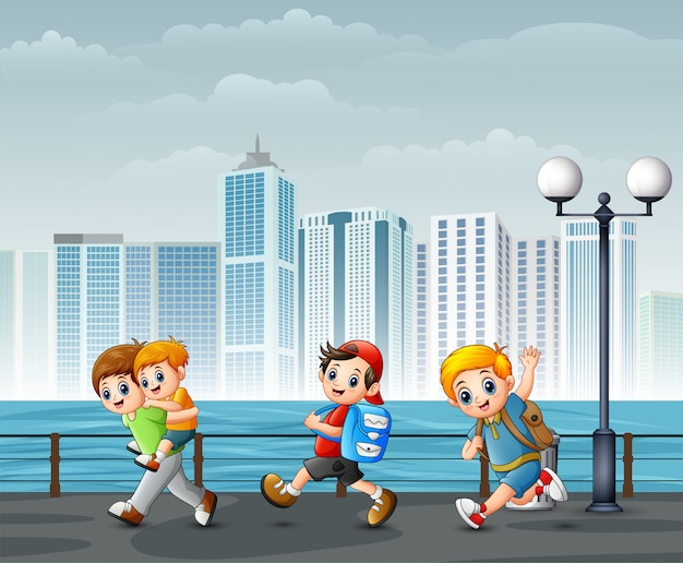 Bambini felici che giocano sulla riva del fiume attraverso le città