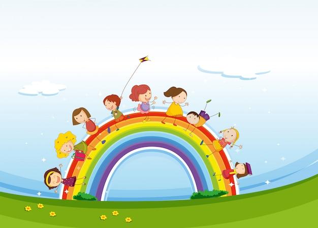 Bambini in piedi sopra l'arcobaleno