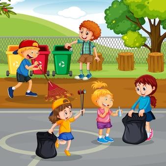 Bambini volontari che puliscono parco