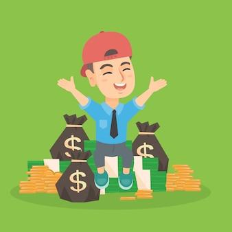 Bambino caucasico del ragazzo che si siede fra i mucchi di soldi.